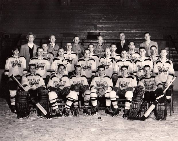 Augie Herchenratter, shown at top right in this 1954 photo, coached the Waterloo Siskins.