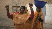 Women dance openly in front of a photographer as they walk along a street in Timbuktu, Mali, Thursday Jan. 31, 2013. (Harouna Traore/Associated Press)