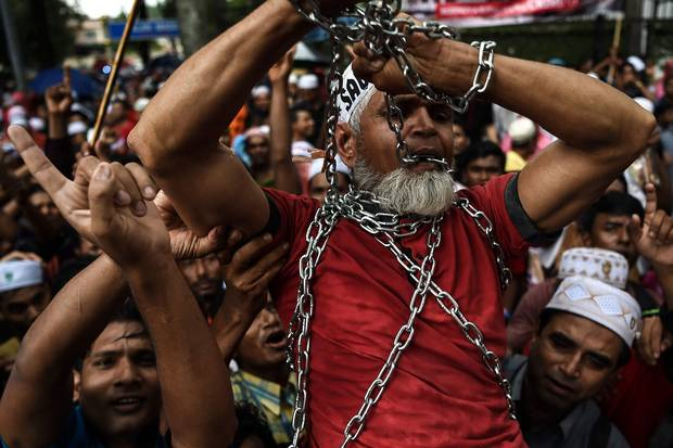 Nov. 25, 2016: Rohingya refugees carry a man in chains during a protest against the persecution of Rohingya outside the Myanmar embassy in Kuala Lumpur.