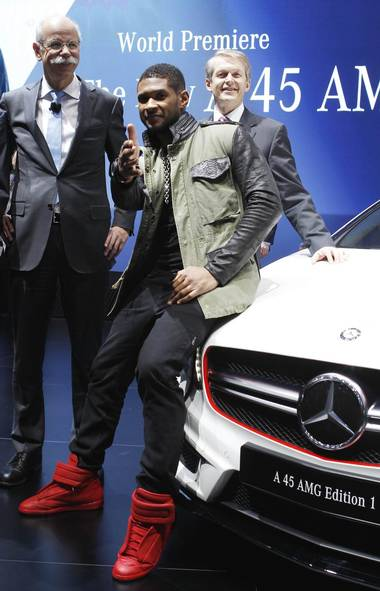 This week in celebrities selling stuff this week: Usher hawks luxury cars in Germany on Tuesday... (Denis Balibouse/Reuters)