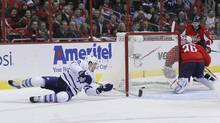 Toronto Maple Leafs' James van Riemsdyk (L) scores the first goal against the Washington Capitals during the first period of their NHL game in Washington February 5, 2013. (JASON REED/Reuters)