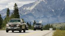 Vehiles drive along the Trans Canada Highway through Banff National Park with Mt. Cascade in the background in this 2008 file photo. (Jeff McIntosh/The Canadian Press)