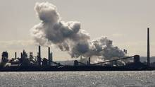 Steam billows from a stack at the U.S. Steel Canada plant, formerly Stelco, in Hamilton, March 4, 2009. (MIKE CASSESE/REUTERS)