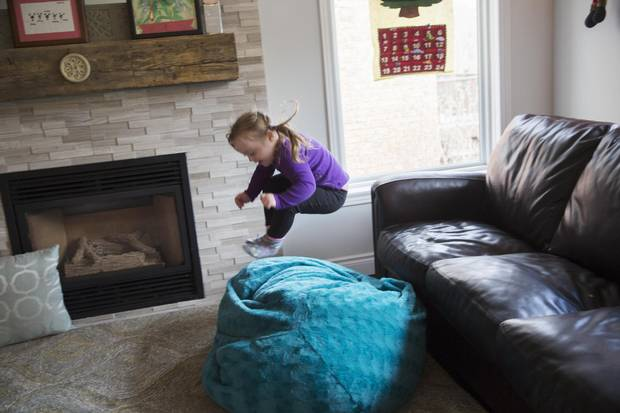 Emma Casagrande, 4, who has Down syndrome, shows her colourful and energetic personality as she plays at home in Guelph, Ont. on Dec. 1, 2017.