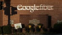 Google Inc. Fiber signage is displayed outside of the company's office in Kansas City, Missouri, U.S., on Tuesday, Nov. 27, 2012. Google Inc. will move a step closer to offering the a new fiber-optic network. (Julie Denesha/Bloomberg)