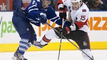 In this file photo, Toronto Maple Leafs' John-Michael Liles, right, battles for the puck with Ottawa Senators' Zack Smith during third period NHL hockey action in Toronto on Saturday October 8, 2011. The Leafs recalled Liles from the Toronto Marlies on Friday and he is expected to suit up for Saturday's clash in Ottawa against the Senators. (CHRIS YOUNG/THE CANADIAN PRESS)