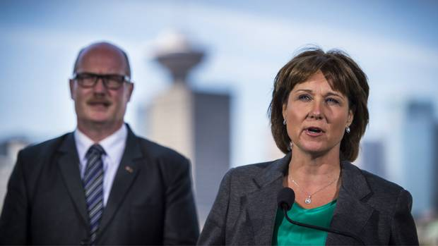 B.C. Premier Christy Clark and B.C. Finance Minister Michael de Jong outline changes to the real estate sector during a news conference in Vancouver.
