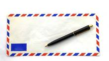 air mail envelope with pen (vichie81/Getty Images/iStockphoto)