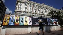 Television ads are posted in front of the Carlton hotel in Cannes. (ERIC GAILLARD/REUTERS)
