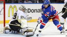 Pittsburgh Penguins goalie Marc-Andre Fleury makes a save against New York Rangers right wing Mats Zuccarello during the third period of Game 3 of the second round of the 2014 Stanley Cup Playoffs at Madison Square Garden. (USA TODAY Sports)