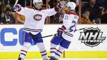 Montreal Canadiens' Tomas Plekanec, left, of the Czech Republic, celebrates with Brian Gionta after Plekanec's goal during the second period of an NHL game against the Philadelphia Flyers, Wednesday, Jan. 8, 2014, in Philadelphia. (Matt Slocum/AP)