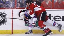 Ottawa Senators' Chris Neil (R) checks New York Rangers' Marc Staal during the third peroid of Game 6 of their NHL Eastern Conference quarter-final playoff hockey game in Ottawa, April 23, 2012. REUTERS/Chris Wattie (CHRIS WATTIE)