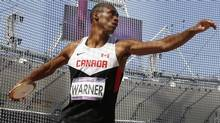 Canada's Damian Warner takes a throw in the discus throw for the decathlon during the athletics in the Olympic Stadium at the 2012 Summer Olympics, London, Thursday, Aug. 9, 2012. (Associated Press)