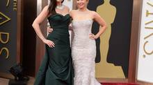 Idina Menzel, left, and Kristen Bell arrive at the Oscars on Sunday, March 2, 2014, at the Dolby Theatre in Los Angeles. (Jordan Strauss/Invision/AP)
