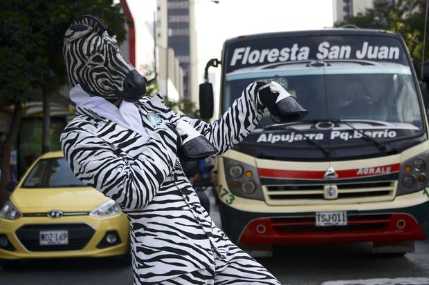 A man dressed in a zebra costume performs on the streets of Medellin, Colombia, for Car and Motorcycle Free Day on April 22, 2015.