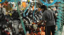 Employees assemble cars in Brampton, Ont. in 2011. (Kevin Van Paassen/The Globe and Mail)