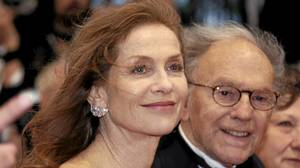 Cast members Isabelle Huppert and Jean-Louis Trintignant arrive on the red carpet for the screening of the film Amour at the 65th Cannes Film Festival, May 20, 2012.