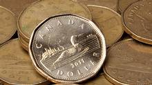 Canadian dollar rises on hopes EU is moving on crisis plan (JONATHAN HAYWARD/THE CANADIAN PRESS)