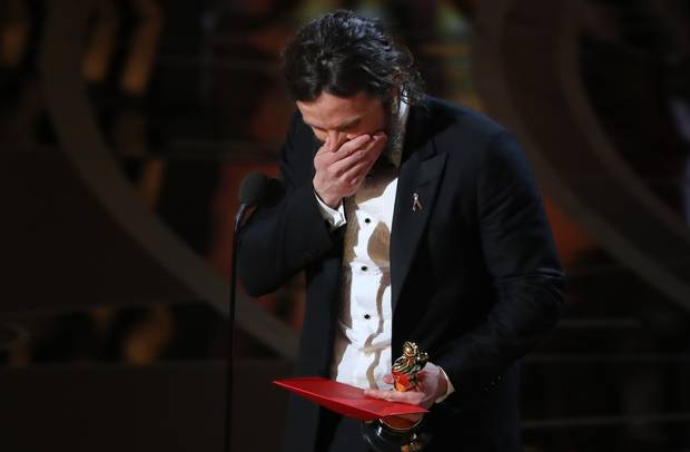Casey Affleck reacts as he accepts the Oscar for Best Actor for