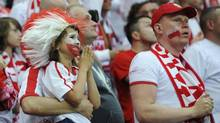 Polish fans react during their Group A Euro 2012 soccer match against Greece at the National Stadium in Warsaw, June 8, 2012. (PAWEL ULATOWSKI/REUTERS)