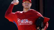 Former Toronto Blue Jays pitcher Roy Halladay works out with his new team as pitchers and catcher officially report to Spring Training at the Philadelphia Phillies' training facility in Clearwater, FL, February 18, 2010. (Darren Calabrese)