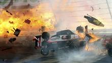 The race car of driver Will Power hits the wall as flames from British driver Dan Wheldon'sæcar burst (at left) during the IZOD IndyCar World Championship race at the Las Vegas Motor Speedway in Las Vegas, Nevada October 16, 2011. Wheldon died from injuries sustained in an horrific crash at the Las Vegas Motor Speedway on Sunday, race organizers said. The 33-year-old Englishman, who lived in Florida, was involved in a multi-car accident 13 laps into the Las Vegas Indy 300 which sent his vehicle flying. REUTERS/Barry Ambrose (Barry Ambrose/Reuters)