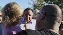 Coalition Avenir Quebec (CAQ) leader Francois Legault greets people while campaigning at a Family Day Festival in Laval, Quebec, September 2, 2012. Quebec voters will go to the polls in a provincial election on September 4. (CHRISTINNE MUSCHI/REUTERS)