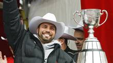Calgary Stampeders kicker Sandro DeAngelis salutes the crowd during a ceremony at Calgary City Hall, Tuesday, Nov. 25, 2008. Thousands came out to see the team after they defeated the Montreal Alouettes 22-14 to win the 96th Grey Cup. (Jeff McIntosh/The Canadian Press)