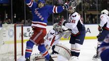 New York Rangers right wing Ryane Clowe celebrates a goal scored by left wing Carl Hagelin in the second period of Game 4 of their first-round NHL hockey Stanley Cup playoff series against the Washington Capitals in New York, Wednesday, May 8, 2013. (Kathy Willens/AP)