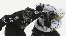 San Jose Sharks center Patrick Marleau (12) pushes Los Angeles Kings defenseman Alec Martinez (27) during the third period of of an NHL hockey game in San Jose, Calif., Thursday, April 3, 2014. (Jeff Chiu/AP)