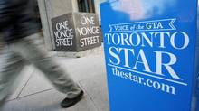 A pedestrian walks past a Toronto Star box in front of the newspaper's offices on Jan. 18, 2008. (MARK BLINCH/REUTERS)
