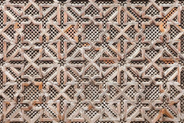 FES, MOROCCO - FEBRUARY 27, 2016: Pattern design element of Madrasa Bou Inania in Fes in Morocco. Madrasa Bou Inania is known as an excellent example of Marinid architecture