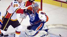 Calgary Flames' Curtis Glencross celebrates his goal against Edmonton Oilers goaltender Nikolai Khabibulin during first-period NHL hockey action in Edmonton on Saturday, October 3, 2009. (John Ulan)