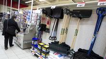 Shovels and snow salt are on display at the Canadian Tire in downtown Toronto on Feb. 6, 2012. (Peter Power/For The Globe and Mail)