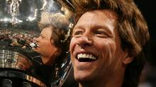 Jon Bon Jovi co-owner of the Philadelphia Soul celebrates with the trophy at the end of the Arena Bowl XXII at the New Orleans Arena on July 27, 2008 in New Orleans, Louisiana. The Philadelphia Soul defeated the San Jose SaberCats 59 to 56. (Marc Serota/Getty Images)
