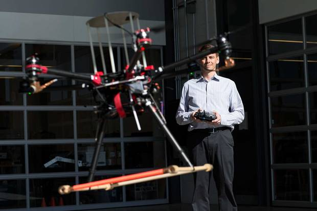 University of Waterloo professor Steven Waslander flies a drone.