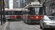 Westbound King Street streetcars lined up in traffic near Spadina Ave. on May 13 2014. (Fred Lum/The Globe and Mail)