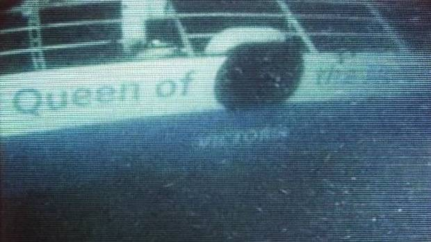 The stern of the sunken ferry Queen of the North is seen in this frame from handout video footage.
