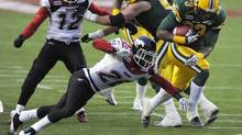 Edmonton Eskimos' Jerome Messam (R) crosses the goal line for a touchdown against Calgary Stampeders' Brandon Smith during their CFL Western semi-final football game in Edmonton November 13, 2011. (DAN RIEDLHUBER/REUTERS)