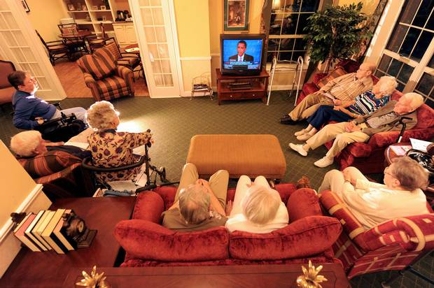 A group of retired seniors gathers at an assisted living residence in Maryland to watch the final presidential debate of 2008 between Barack Obama and John McCain.
