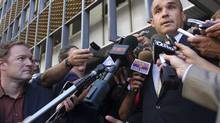 BlackBerry billionaire Jim Balsillie answers reporters' questions after leaving a U.S. Bankruptcy Court hearing Wednesday in Phoenix. (JOSHUA LOTT/Joshua Lott/Reuters)