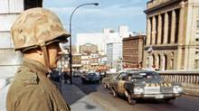 Soldiers of the Royal 22nd Regiment from Quebec City stands guard on a Montreal bridge after the War Measures Act was invoked in October, 1970. (Canadian Press)