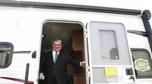 Canada's Finance Minister Jim Flaherty steps out of a recreational vehicle after making an announcement in Ottawa September 9, 2013. Flaherty announced a three-year freeze on employment insurance (EI) premium rates at 2013 levels in September 2013. (BLAIR GABLE/REUTERS)