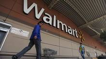 Shoppers walk from a Wal-Mart store in Mexico City in this August 15, 2012 file photo. (EDGARD GARRIDO/REUTERS)