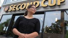 Shelby Kennedy stands outside a Second Cup coffee shop on Friday, May 5, 2013 in Halifax, Nova Scotia. Kennedy, who has worked at the store location for over a year, is participating in an union drive there that she hopes will serve as a model for baristas across Canada. (Mike Dembeck/THE CANADIAN PRESS)
