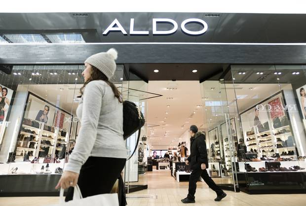Shoppers walk past the Aldo store in Toronto's Yorkdale Shopping Centre.