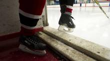 A hockey player takes the ice in Toronto in this file photo. (Kevin Van Paassen/The Globe and Mail)