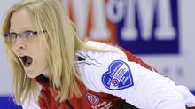 Team Canada skip Amber Holland reacts to her shot while playing Newfoundland/Labrador at the Scotties Tournament of Hearts curling championship in Red Deer, Alberta February 18, 2012. REUTERS/Todd Korol (Todd Korol/Reuters)