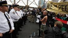 Police square off against protesters on the Brooklyn Bridge during an Occupy Wall Street march in New York October 1, 2011. (Jessica Rinaldi/Reuters/Jessica Rinaldi/Reuters)