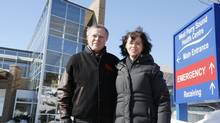 A series of accidents and tragedies brought home the importance of the hospital to Joe and Fatima Bamford, shown outside the West Parry Sound Health Centre. (TED KRUG FOR THE GLOBE AND MAIL)